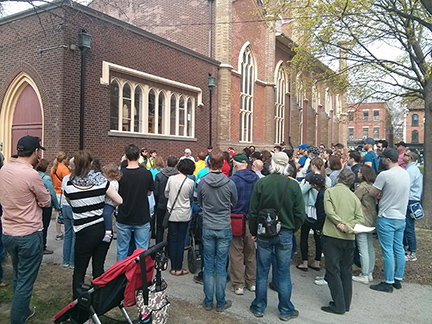 Crowd gathered outside Little Trinity Church for the Three Centuries of Corktown walk during Jane's Walk